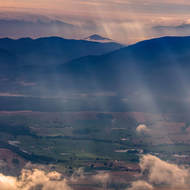 Rain, clouds and sun rays over northern Tasmania.